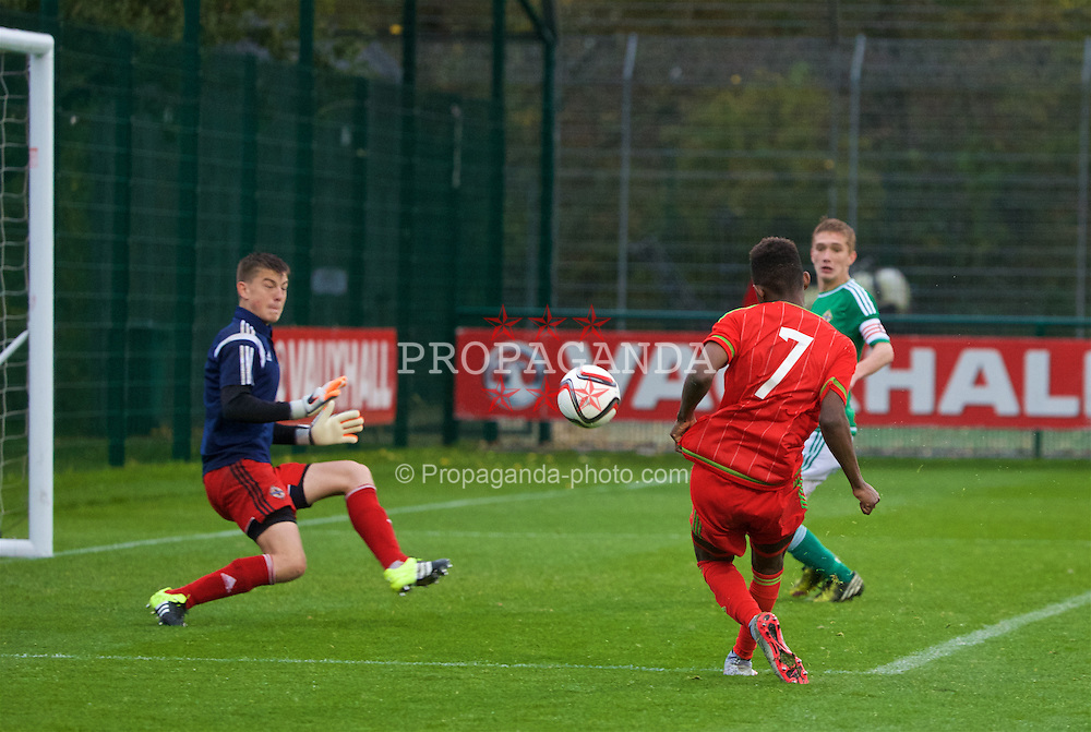 NEWPORT, WALES - Thursday, November 5, 2015: Wales' Rabbi Matonda scores the second goal past Northern Ireland's goalkeeper Oliver Webber during the Under-16's Victory Shield International match at Dragon Park. (Pic by David Rawcliffe/Propaganda)