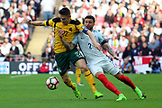 Kyle Walker of England battles for possession with Fedor Cernych of Lithuania during the FIFA World Cup Qualifier group stage match between England and Lithuania at Wembley Stadium, London, England on 26 March 2017. Photo by Matthew Redman.
