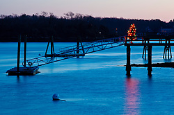 A Christmas tree lights a boat dock in New Castle, New Hampshire.