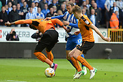 Brighton & Hove Albion centre forward Glenn Murray (17) battles with Wolverhampton Wanderers defender Kortney Hause (30) and Wolverhampton Wanderers midfielder Dave Edwards (4) 0-0 during the EFL Sky Bet Championship match between Wolverhampton Wanderers and Brighton and Hove Albion at Molineux, Wolverhampton, England on 14 April 2017. Photo by Alan Franklin.