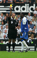 Photo: Andrew Unwin.<br />Newcastle United v Wigan Athletic. The Barclays Premiership. 19/08/2006.<br />Wigan's Emile Heskey (R) picks up a yellow card from the referee, Martin Atkinson (L).
