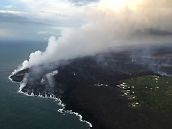 Handout photo of the ocean entry being fed by a crusted over channel has fewer tiny ooze-out channels than yesterday spilling into the water. One larger ooze-out channel making dominant entry plume at the northern end of the broad ocean entry. Kilauea Volcano, HI, USA, July 2, 2018. Photo by USGS via ABACAPRESS.COM