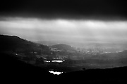 A stormy sky approaches Windermere from Kirkstone Pass, Lake District