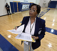 August , 2013 - Atlanta:  African American teacher Rhonda Robinson  calls roll on the first day of school at B.E.S.T Academy (Business Engineering Science Technology) on Wednesday, August 7 ,2013.  Over 80 members of the 100 Black Men of Atlanta greeted the boys and their parents as they arrived at school.  The boys were inspired by former Atlanta Mayor Andrew Young to become leaders in the community.  Young spoke to boys in the middle school and high School.  The school is an all male school.  Today was the first day back to school for students in Atlanta.  ©2012 Johnny Crawford
