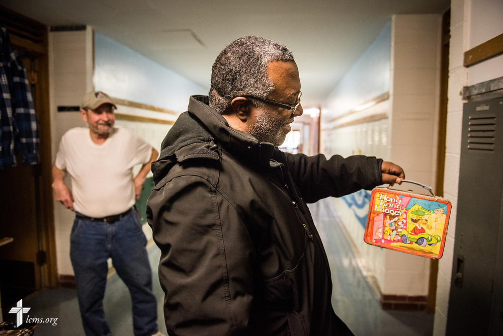 The Rev. Delwyn Campbell, national missionary to Gary, Ind., eyes a vintage lunchbox from the mid-1970s found in an old school locker found by Ascension Lutheran Church member Ron Webster at the church in Gary, Ind., on Wednesday, April 5, 2017. Webster found the lunchbox during the process of renovating the building for the upcoming Ascension Lutheran School. LCMS Communications/Erik M. Lunsford