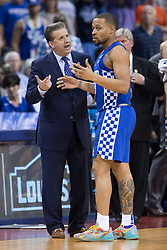 Kentucky head coach John Calipari, left, talks with Kentucky guard Isaiah Briscoe in the second half. North Carolina won 75-73.<br /> <br /> The University of Kentucky hosted the University of North Carolina in a 2017 NCAA D1 Men's South Regional Championship, Sunday, March 26, 2017 at FedExForum in Memphis.