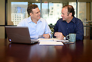 Two businessmen meet in a conference room in Dallas, Texas.