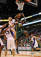 Mar. 14, 2012; Phoenix, AZ, USA;  Utah Jazz forward Paul Millsap (24) is fouled by the Phoenix Suns center Marcin Gortat (4) during the second half at the US Airways Center.  The Suns defeated the Jazz 120-111. Mandatory Credit: Jennifer Stewart-US PRESSWIRE.
