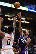 Mar 15, 2017; Phoenix, AZ, USA; Sacramento Kings center Willie Cauley-Stein (00) shoots the ball over Phoenix Suns forward Marquese Chriss (0) in the second half at Talking Stick Resort Arena. The Sacramento Kings won 107 - 101. Mandatory Credit: Jennifer Stewart-USA TODAY Sports