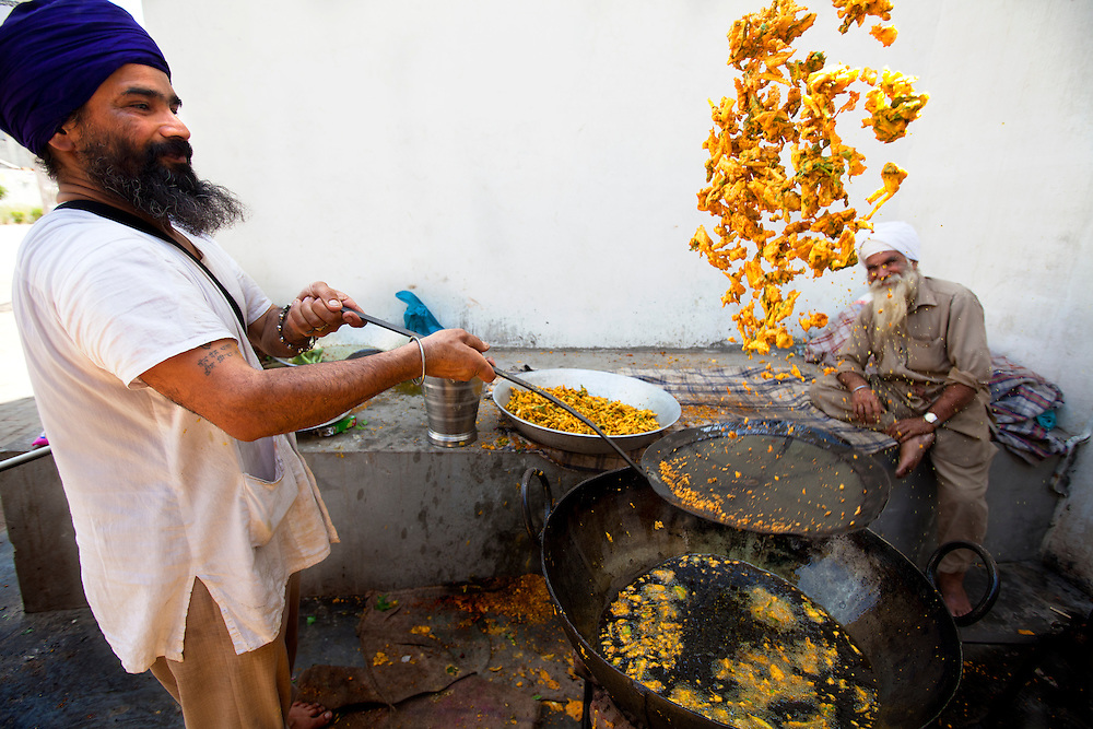 A Sikh cook making pakora at a Sikh temple. The Sikh kitchen is an Important part of a sikh kitchen and provides food for the pilgrims.