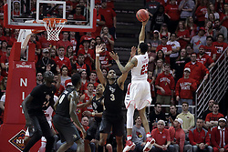 20 March 2017:  Deontae Hawkins(23) shoots over A.J. Davis during a College NIT (National Invitational Tournament) 2nd round mens basketball game between the UCF (University of Central Florida) Knights and Illinois State Redbirds in  Redbird Arena, Normal IL