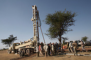 Drilling for water at Koye Tajaba Village, Ethiopia. Here a bore hole is being created, with the rig boring down to a depth of approximately 160 meters to the underground water table. Once tapped a 3km pipeline extension will tranport the water to a disturbution point. The bore hole is expected to supply 1,500 beneficiaries.