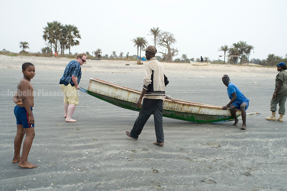 Tourists helping out a stranded fisher boat