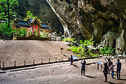 13 May 2017. Phraya Nakhon Cave, Thailand.<br /> Visitors take pictures in front of The Tetrahedron Pavilion deep inside Phraya Nakhon Cave, Thailand. The natural cave is an historic place in Thailand due to three great Thai King's visiting it in the past. <br /> Photographer: Rick Findler