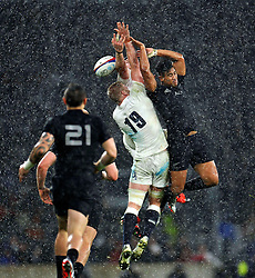 George Kruis of England and Julian Savea of New Zealand compete for the ball in the air - Photo mandatory by-line: Patrick Khachfe/JMP - Mobile: 07966 386802 08/11/2014 - SPORT - RUGBY UNION - London - Twickenham Stadium - England v New Zealand - 2014 QBE Internationals