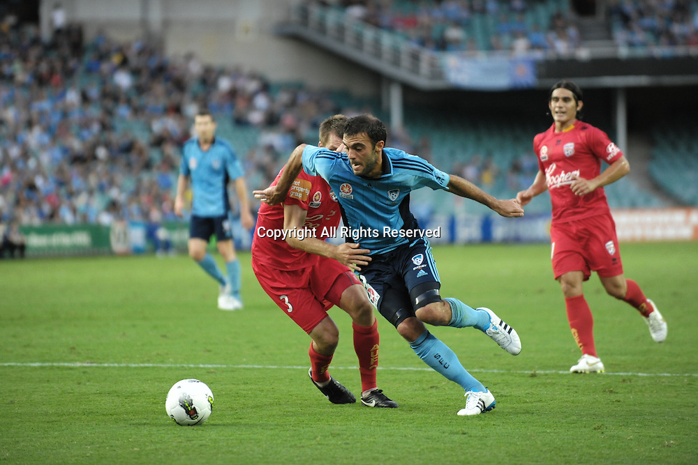 22.12.2011 Sydney, Australia.Sydney forward  Bruno Cazarine about to be fouled by Adelaide defender Nigel Boogaard and a resulting penalty during the A-League game between Sydney FC and Adelaide United played at the Sydney Football Stadium.