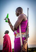 A Masai warrior at sunset, Masai Mara, Kenya.