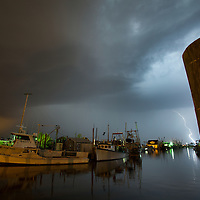 Lightning streaking through the sky seen from the Belford Seafood Co-Operative in Belford New Jersey
