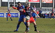 Mary Onianwa and Georgie Giddings battling for posession during the FA Women's Cup match between Crystal Palace LFC and Reading Women at Bromley, England on 8 February 2015. Photo by Michael Hulf.