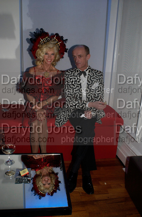Countess Gunilla von Bismarck and gottfried von bismarck. Andy & Patti Wong's Chinese New Year party to celebrate the year of the Rooster held at the Great Eastern Hotel, Liverpool Street, London.29th January 2005. The theme was a night of hedonism in 1920's Shanghai. . ONE TIME USE ONLY - DO NOT ARCHIVE  © Copyright Photograph by Dafydd Jones 66 Stockwell Park Rd. London SW9 0DA Tel 020 7733 0108 www.dafjones.com