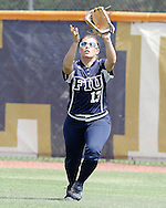 Alexandra Casals goes in to make a catch in left field during the game against rival Troy on Sunday