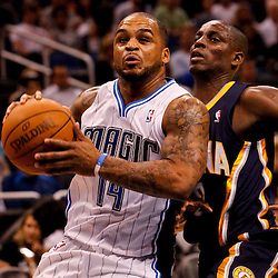 March 11, 2012; Orlando, FL, USA; Orlando Magic point guard Jameer Nelson (14) drives past Indiana Pacers point guard Darren Collison (2) during the first quarter of a game at  Amway Center.   Mandatory Credit: Derick E. Hingle-US PRESSWIRE