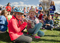 "Lilly and Taylor from Pleaseant Street School show off their ""safe kids"" and ""PSS Pride"" stickers following their bike ride on the WOW Trail Monday afternoon.  (Karen Bobotas/for the Laconia Daily Sun)"