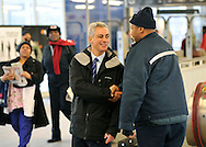 Chicago Mayor-elect Rahm Emanuel, center, greets commuters at a train station on February 23, 2011 in Chicago. (AP)