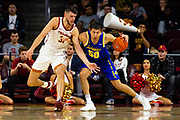 Southern California Trojans forward Nick Rakocevic (31) defends South Dakota State forward David Wingett (50) during the first half of an NCAA basketball game, Tuesday, Nov. 12, 2019, in Los Angeles. USC defeated South Dakota State 84-66. (Brandon Sloter/Image of Sport)