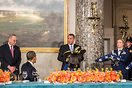 House Speaker John Boehner (R-OH) presents President Barack Obama with the gift of the flag that flew over the U.S. Capitol during his Inauguration at the Inaugural Luncheon in Statuary Hall at the U.S. Capitol on Monday, January 21, 2013 in Washington, DC.