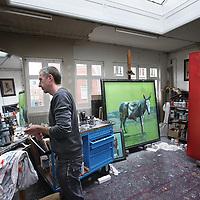 Nederland, Amsterdam , 7 februari 2013..De beeldend kunstenaar Sam Drukker in zijn atelier..Dutch painter and visual artist Sam Drukker in his workshop between his paintings.