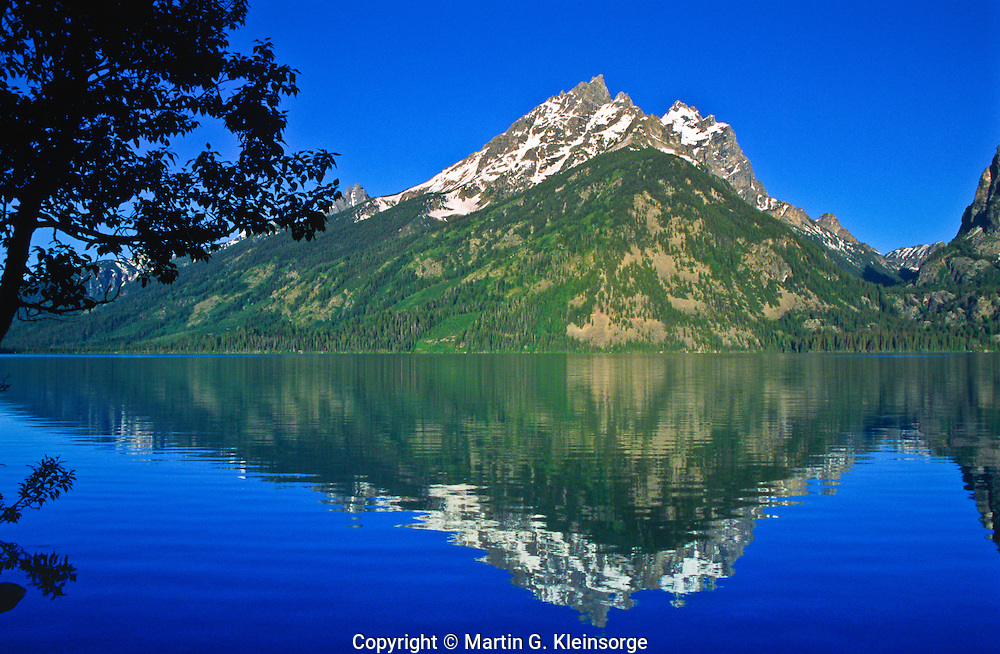 Reflections of the Cathedral Group in Genny Lake.  Grand Teton National Park.  Wyoming, USA