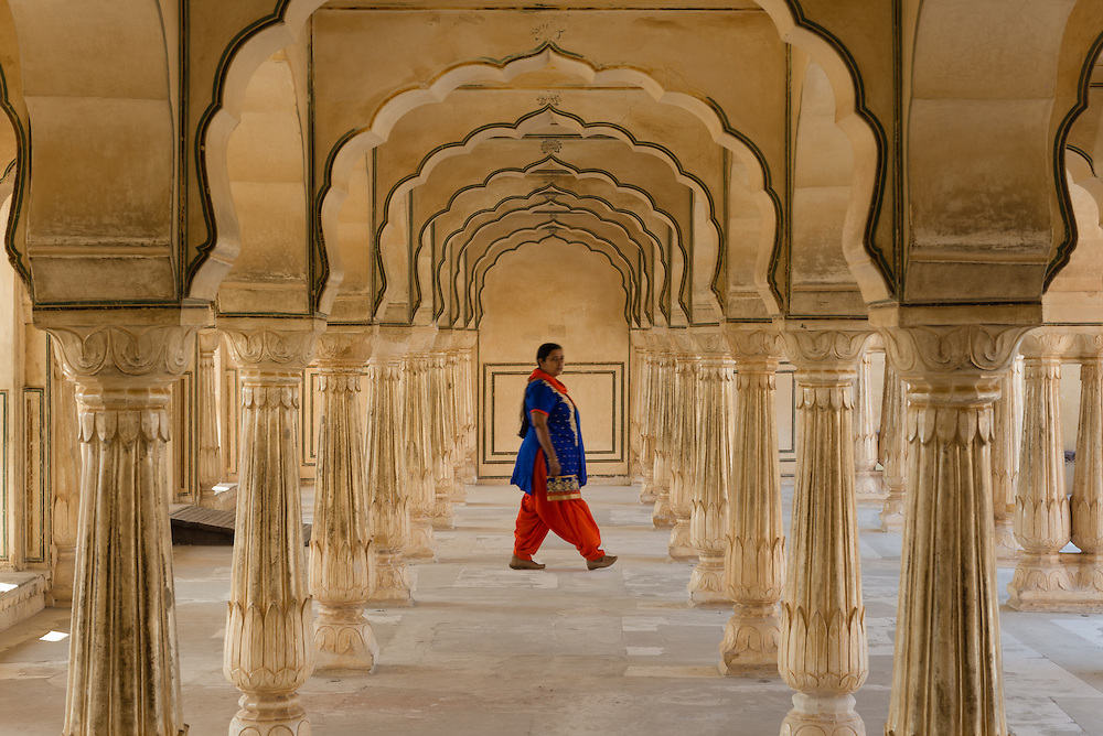 Blurred figure moving through arches at Amber Fort