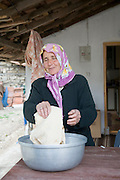 Turkey, Antalya, Koprulu River Canyon, The small village of Selge, Local woman preparing pita bread