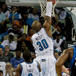 12 April 2009: New Orleans Hornets forward David West (30) dunks during a 102-92 victory by the New Orleans Hornets over the Dallas Mavericks on Easter Sunday at the New Orleans Arena in New Orleans, Louisiana.
