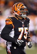 Cincinnati Bengals defensive tackle Devon Still (75) jogs off the field at halftime during the NFL week 10 regular season football game against the Cleveland Browns on Thursday, Nov. 6, 2014 in Cincinnati. Still's daughter Leah Still was diagnosed with cancer and appeared on the field earlier in the game as part of the 2014 Devon Still Jersey Program. The Browns won the game 24-3. ©Paul Anthony Spinelli