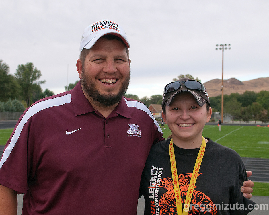 Bill and Sam Buhrig, father and daughter radio announcing team before the start of the Vale - Baker football game, September 26, 2014 at Frank Hawley Stadium, Vale, Oregon.
