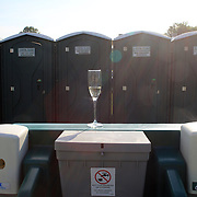 A champagne glass left outside the portable toilets during the Airstream vs. Cinque Terre Polo match at the Greenwich Polo Club, Greenwich, Connecticut, USA. 23rd June 2013. Photo Tim Clayton