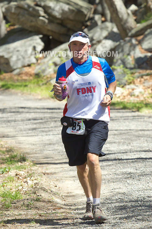 Gardiner, New York - Michael Tobin competes in the Rock the Ridge 50-mile endurance challenge race at the Mohonk Preserve on May 4, 2013. The race is part of Mohonk's 50th anniversary celebration and a fundraiser for the preserve.