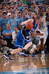 CHAPEL HILL, NC - MARCH 05: Kyle Singler #12 of the Duke Blue Devils dribbles the ball while pressured by Harrison Barnes #40 of the North Carolina Tar Heels on March 05, 2011 at the Dean E. Smith Center in Chapel Hill, North Carolina. North Carolina won 67-81. (Photo by Peyton Williams/UNC/Getty Images) *** Local Caption *** Kyle Singler;Harrison Barnes