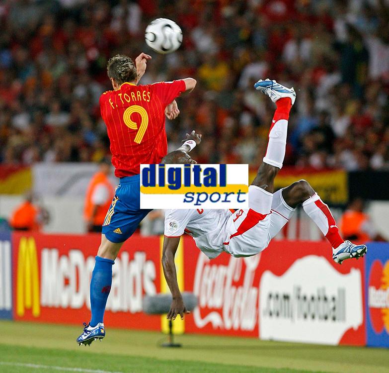 Photo: Glyn Thomas.<br />Spain v Tunisia. FIFA World Cup 2006. 19/06/2006.<br /> Tunisia's Hatem Trabelsi (R) plays a spectacular overhead kick past Spain's Fernando Torres.