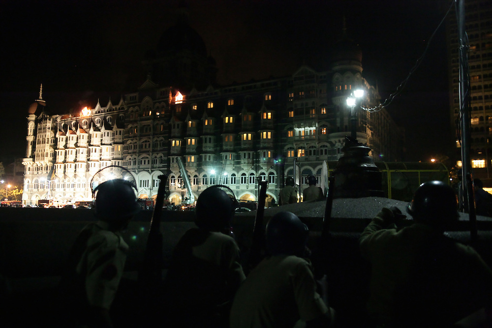 Indian soldiers watched the Taj hotel engulfed by flames during the terrorist attack in Colaba district (Mumbai, India). Multiple sites in the Indian city of Mumbai were attacked with bombs and gunfire in a coordinated terror attack that began on November 26, 2008 and lasted for three days. The attacks killed 179 people, including at least 22 foreigners and over 300 injuries were reported.