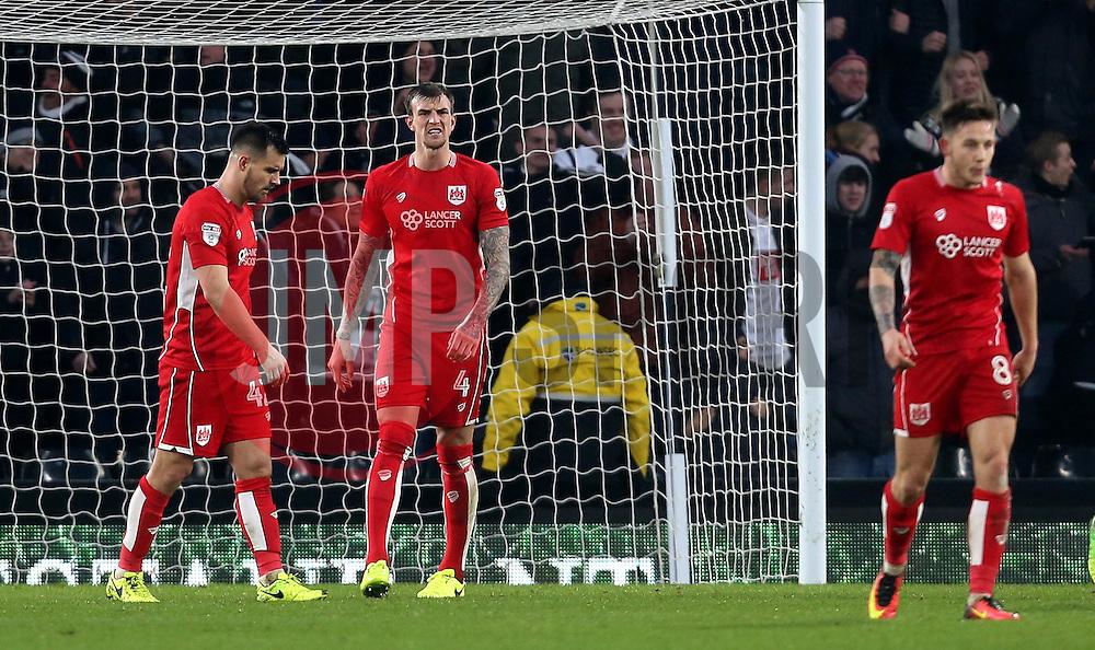 Aden Flint, Bailey Wright and Josh Brownhill of Bristol City look frustrated - Mandatory by-line: Robbie Stephenson/JMP - 11/02/2017 - FOOTBALL - iPro Stadium - Derby, England - Derby County v Bristol City - Sky Bet Championship