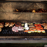 South America, Argentina, Buenos Aires. Open grill with variety of meats and vegetables at La Boca restaurant.