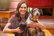 "Pro climber and Base jumper, Steph Davis at home in Moab with beloved companions ""Mao"" the cat and ""Cajun"" the blue heeler."