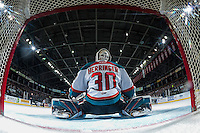 KELOWNA, CANADA - MARCH 4: Michael Herringer #30 of the Kelowna Rockets stretches on the ice against the Tri-City Americans on March 4, 2017 at Prospera Place in Kelowna, British Columbia, Canada.  (Photo by Marissa Baecker/Shoot the Breeze)  *** Local Caption ***