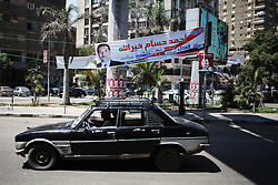 A poster promotes independent candidate and former police officer Ahmed Hossam Khairallah..