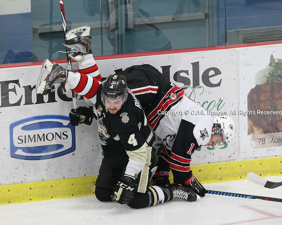 GEORGETOWN, ON  - APR 18,  2017: Ontario Junior Hockey League, Championship Series. Georgetown Raiders vs the Trenton Golden Hawks in Game 3 of the Buckland Cup Final. Chays Ruddy #4 of the Trenton Golden Hawks makes the hit on Keegan Blasby #11 of the Georgetown Raiders during the first period.<br /> (Photo by Tim Bates / OJHL Images)