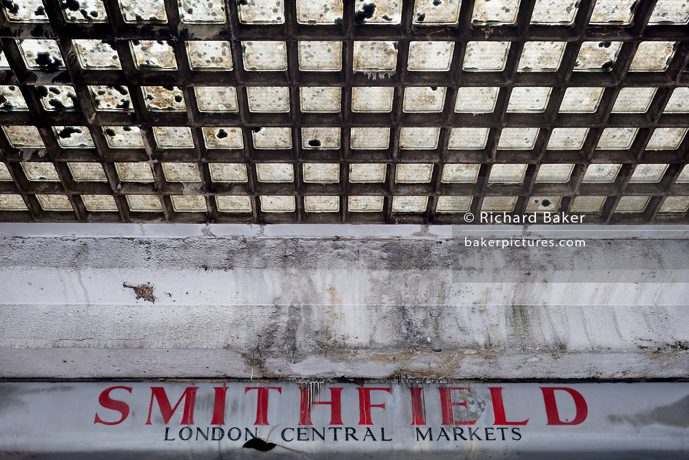 An architectural detail of a closed butcher business in the former Smithfield meat market that is awaiting future redevelopment, on 20th November 2019, at Smithfield in the City of London, England. In March 2015, the Museum of London revealed plans to vacate its Barbican site and move into the General Market Building. The cost of the move is estimated to be in the region of £70 million and, if funding can be achieved, would be complete by 2021. There has been a market on this location since the Bartholomew Fair was established in 1133 by Augustinian friars.