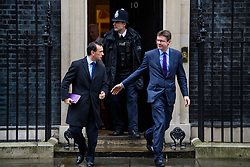 © Licensed to London News Pictures. 08/03/2017. London, UK. Secretary of State for Wales ALUN CAIRNS and Secretary of State for Business, Energy and Industrial Strategy GREG CLARK leave Downing Street following a cabinet meeting before British chancellor Philip Hammond delivers his 2017 Budget to Parliament. Photo credit: Ben Cawthra/LNP